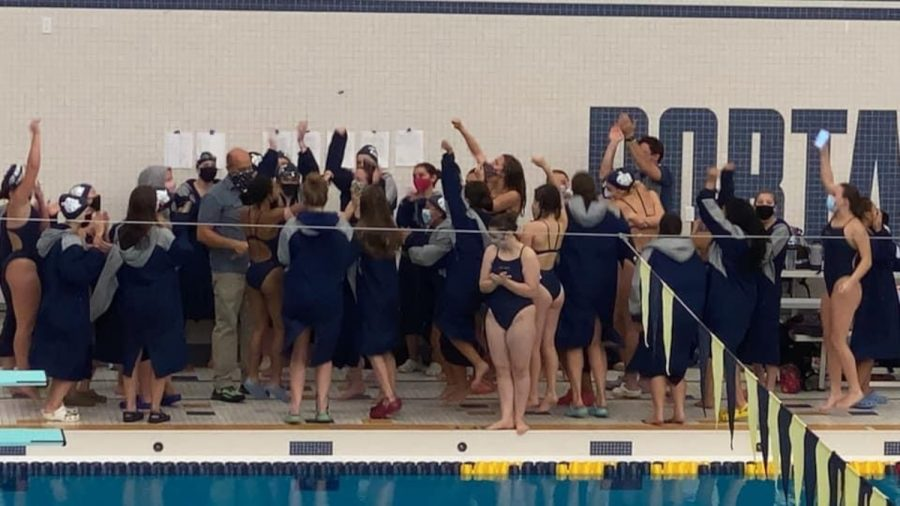 The+Women%27s+Swimming+and+Diving+team+celebrate+their+win+against+Portage+Central.