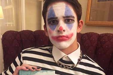 Jack Fergusson in his Halloween costume for 2019, an eboy clown. While showing off the book