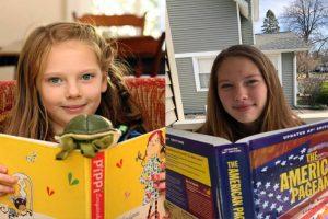 On the left, Mara Vander Beek reading