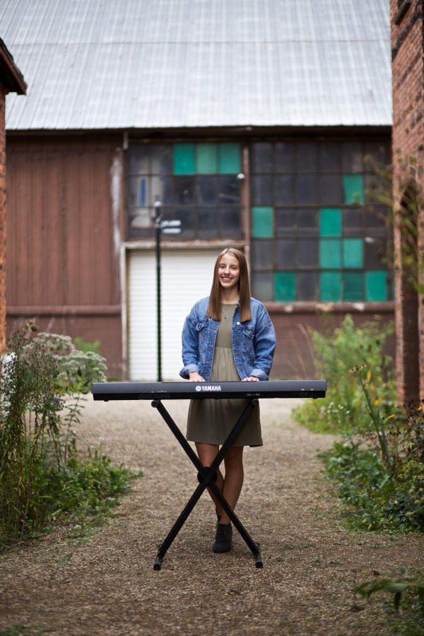 Wallis dedicates some of her senior photos to showcase her love and passion for music.