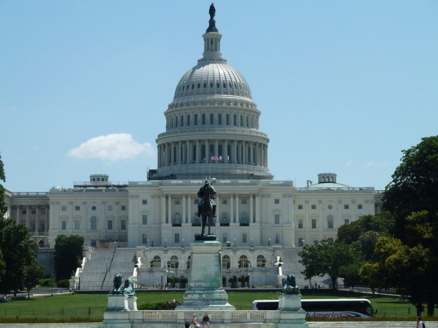 The photo shows the United States Capitol building. In which the House of Representatives and Senate are housed, and decisions are made.