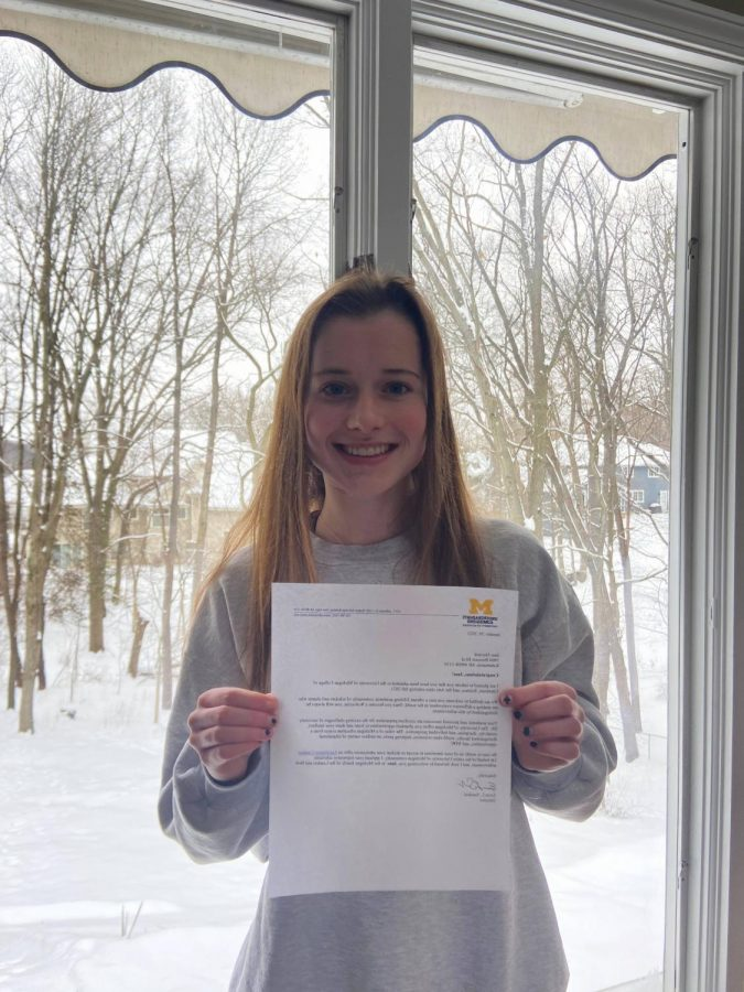 Heystek poses with her acceptance letter to University of Michigan. She is still awaiting letters from multiple schools.
