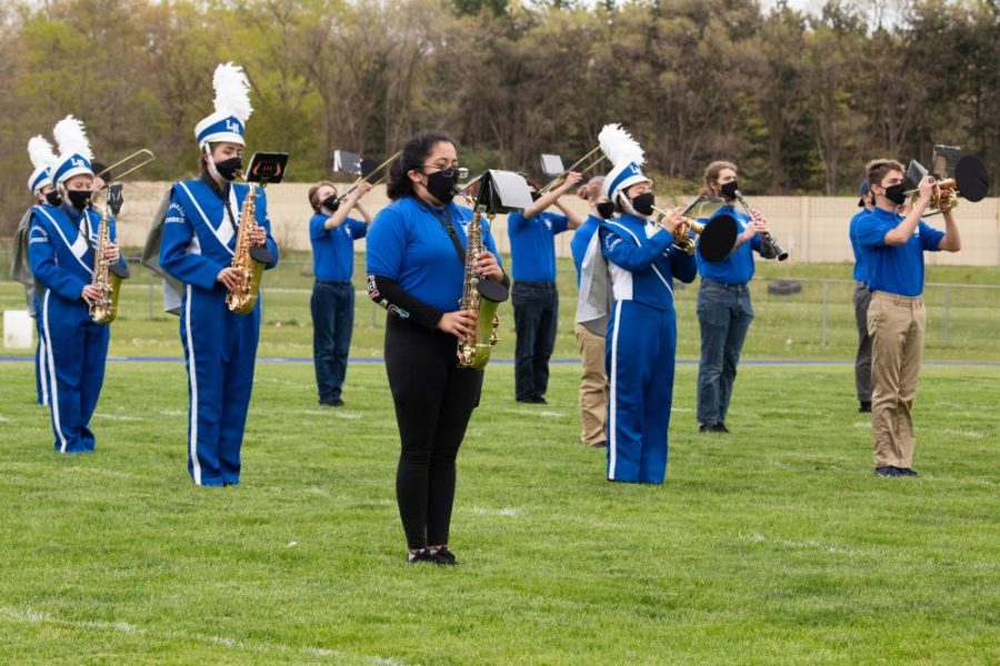 Loy Norrix band preforms on Norrix football field on May 5th. They are wearing their musician specific PPE.