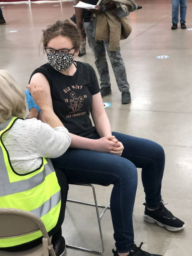 Loy Norrix senior Katie Kutzko gets her second dose of the Pfizer-BioNTech vaccine at the Kalamzoo County Expo Center.