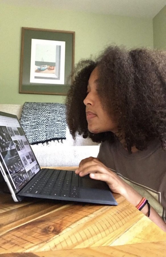 Sophomore, Hannah Getachew completes school work and attends NEHS meetings from her laptop.