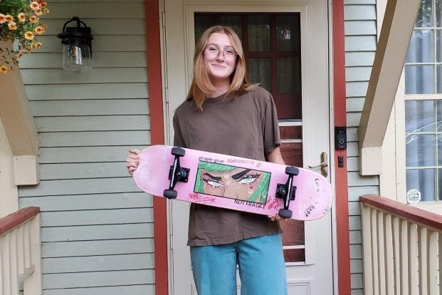 Sophomore Lucy Langerveld poses with her skateboard. She has been skating for a little over a year.